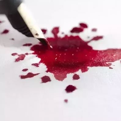 Pen with ink blood splatter