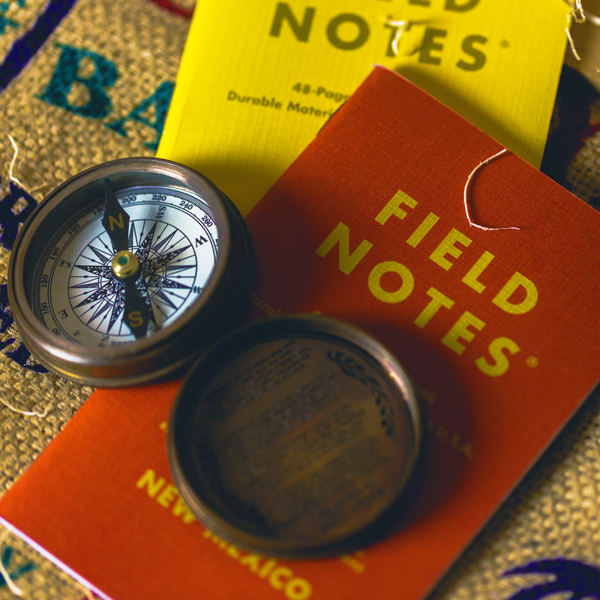 Compass and field note book