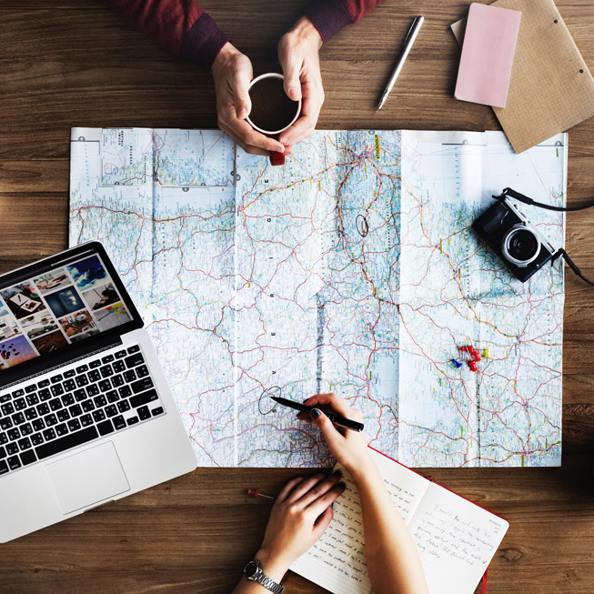Map, laptop and writing tools