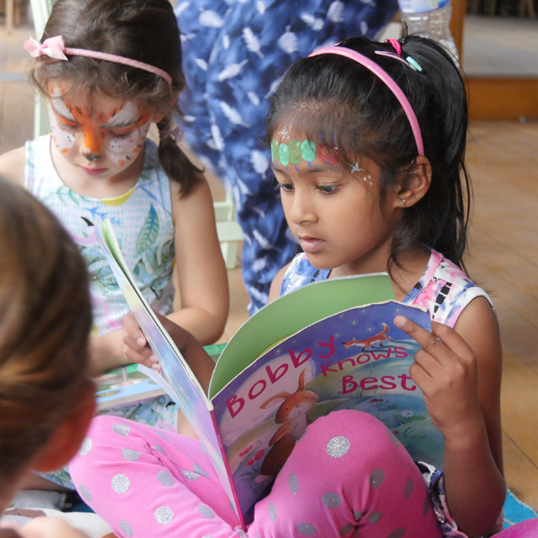 Young children reading books together