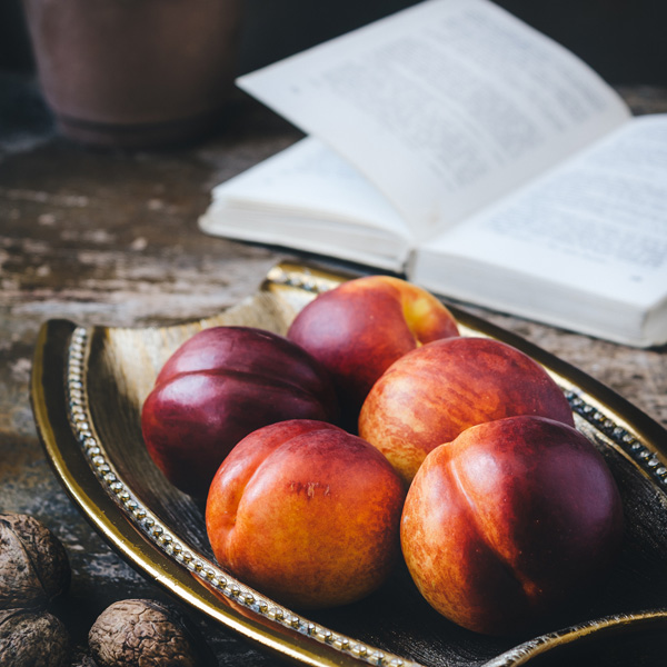 Fruit on a plate with a book